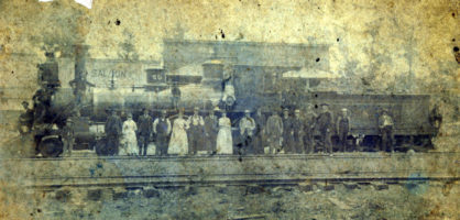 Cleveland-early photo-people on tracks-steam engine